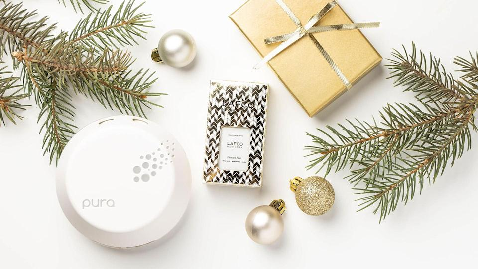 """<p>You've heard of a smart TV and a smart speaker — but have you ever heard of a smart air freshener? Pura is a device which allows users to control the scent of their home using their phone: They can choose when they want the air freshener to run (so there's no wasted fragrance), and what scent they'd like it to emit (it can hold two fragrances at one time). Plus, the brand partners with popular fragrance companies like LAFCO, Capri Blue and NEST!</p> <p><strong>Buy It!</strong> $44, <a href=""""https://www.trypura.com/collections/fragrances/products/pura-device-2-0"""" rel=""""nofollow noopener"""" target=""""_blank"""" data-ylk=""""slk:trypura.com"""" class=""""link rapid-noclick-resp"""">trypura.com</a></p>"""