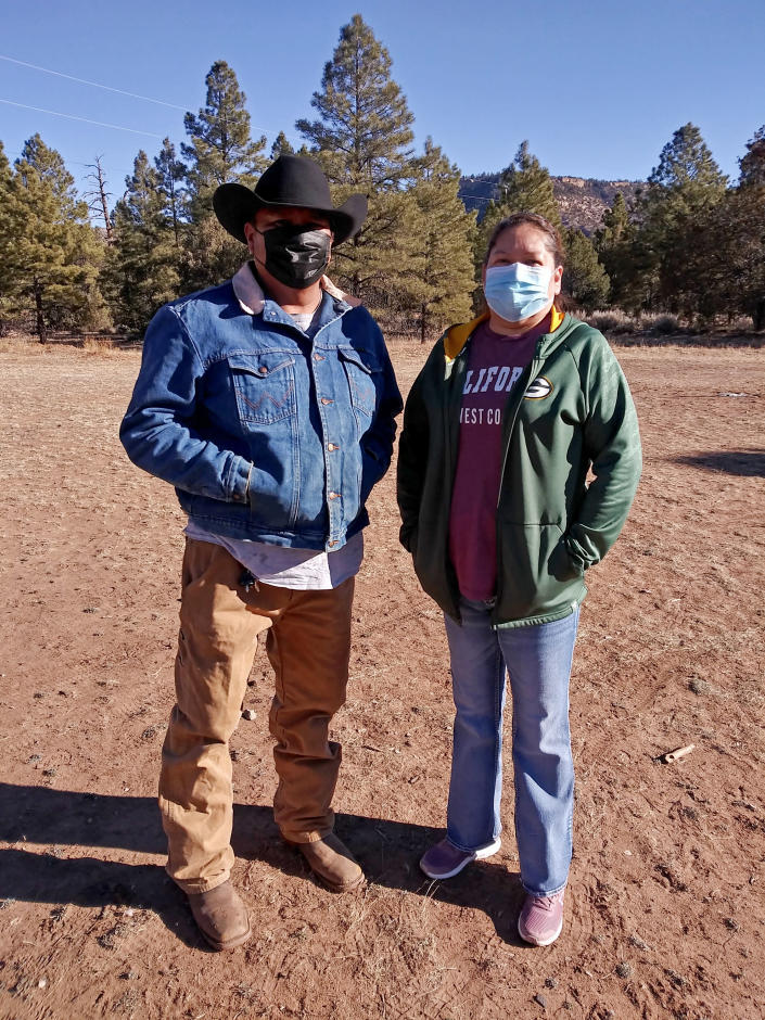 TIME FOR MOVEMENT AT 9 AM EST SATURDAY, JAN. 2 This undated photo provided by Arvena Peshlakai shows Melvin Luke Peshlakai, left, and Arvena Peshlakai at their home in Crystal, New Mexico. The couple volunteered to participate in coronavirus vaccine trials on the Navajo Nation. As coronavirus vaccines were being developed around the world, few Native American tribes signed up to participate. The reasons range from unethical practices of the past to the quick nature of the studies amid the pandemic. Native researchers say without participation from tribal communities, tribes won't know which vaccine might best be suited for their citizens. (Courtesy Arvena Peshlakai via AP)
