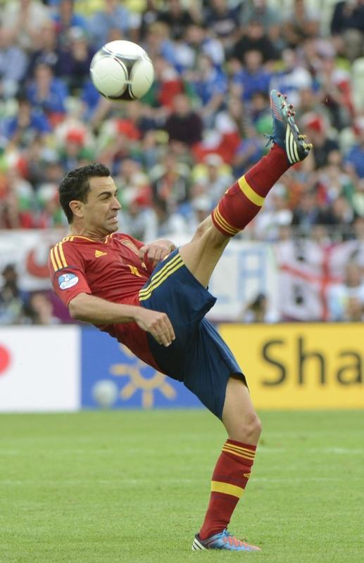 Spanish midfielder Xavi Hernandez kicks the ball during the Euro 2012 championships football match Spain vs Italy on June 10, 2012 at the Gdansk Arena. AFP PHOTO / PIERRE-PHILIPPE MARCOUPIERRE-PHILIPPE MARCOU/AFP/GettyImages