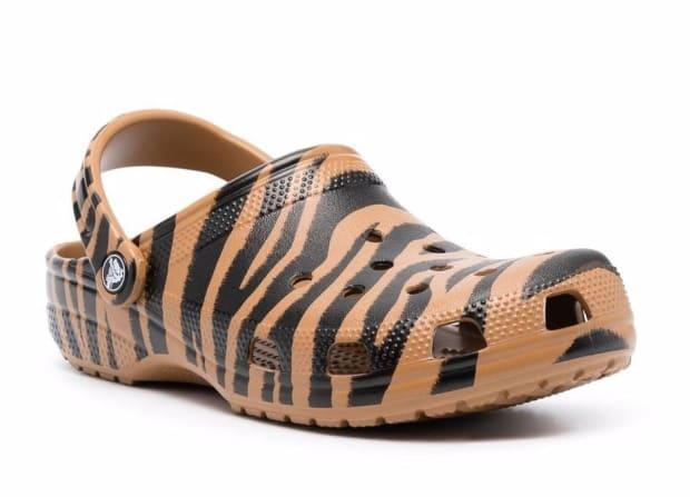 """<p>Crocs Zebra-Print Slides, $55 (from $58), <a href=""""https://rstyle.me/+d1vLm5V65UUdocD2nHJkyw"""" rel=""""nofollow noopener"""" target=""""_blank"""" data-ylk=""""slk:available here."""" class=""""link rapid-noclick-resp"""">available here.</a> </p>"""
