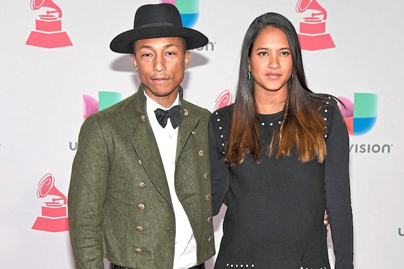 In awe: Pharrell Williams with his wife Helen Lasichanh: Ethan Miller/Getty