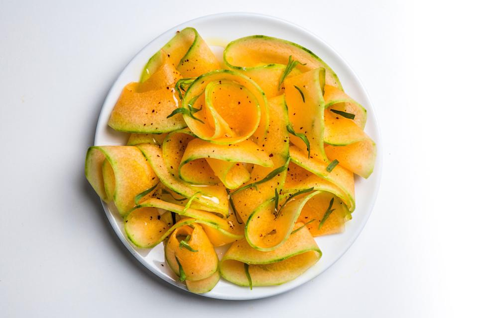 """When shopping for this salad at the market, pick heavy, aromatic cantaloupes with stem ends that yield slightly when pressed. <a href=""""https://www.bonappetit.com/recipe/savory-shaved-cantaloupe-salad?mbid=synd_yahoo_rss"""" rel=""""nofollow noopener"""" target=""""_blank"""" data-ylk=""""slk:See recipe."""" class=""""link rapid-noclick-resp"""">See recipe.</a>"""
