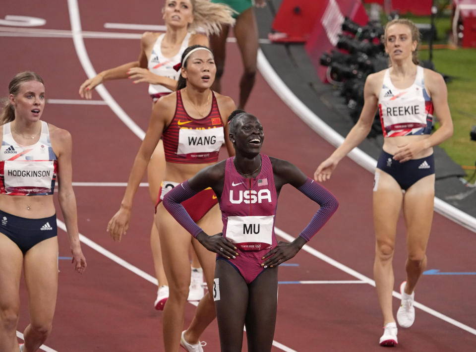 Athing Mu, of United States smiles after winning the gold medal ahead in the final of the women's 800-meters at the 2020 Summer Olympics, Tuesday, Aug. 3, 2021, in Tokyo, Japan. (AP Photo/Charlie Riedel)
