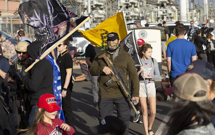 Supporters of Donald Trump gather at a Stop the Steal protest in Phoenix, Arizona - Cheney Orr/Bloomberg