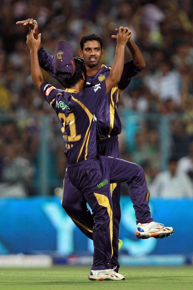 Sachitra Senanayake is congratulated by his teammates after taking the wicket of Ajinkya Rahane during match 47 of the Pepsi Indian Premier League between The Kolkata Knight Riders and the Rajasthan Royals held at Eden Gardens Stadium in Kolkata on the 3rd May 2013. Photo by Jacques Rossouw-IPL-SPORTZPICS ..Use of this image is subject to the terms and conditions as outlined by the BCCI. These terms can be found by following this link:..https://ec.yimg.com/ec?url=http%3a%2f%2fwww.sportzpics.co.za%2fimage%2fI0000SoRagM2cIEc&t=1506398584&sig=H6xOdQB3.4pkjYHtyV8Cig--~D