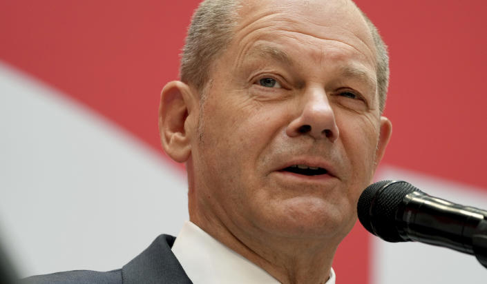 Olaf Scholz, top candidate for chancellor of the Social Democratic Party (SPD), speaks during a press conference at the party's headquarters in Berlin, Germany, Monday, Sept. 27, 2021. The center-left Social Democrats have won the biggest share of the vote in Germany's national election. They narrowly beat outgoing Chancellor Angela Merkel's center-right Union bloc in a closely fought race that will determine who succeeds the long-time leader at the helm of Europe's biggest economy. (AP Photo/Michael Sohn)