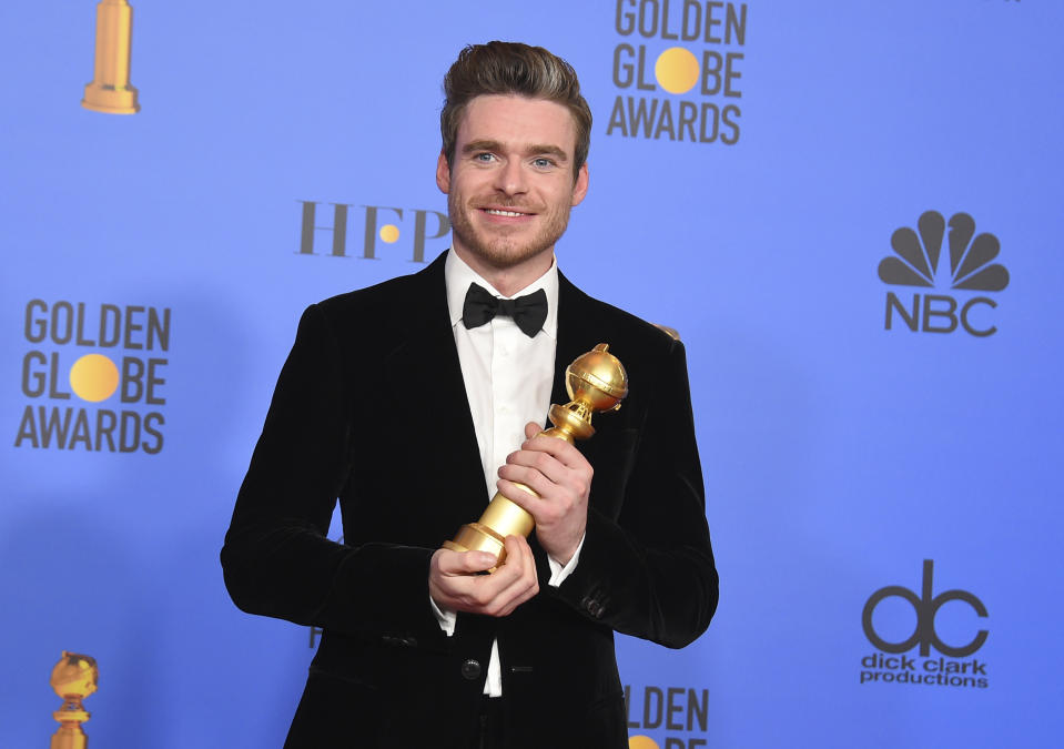 Richard Madden poses in the press room with the award for best performance by an actor in a television series, drama for