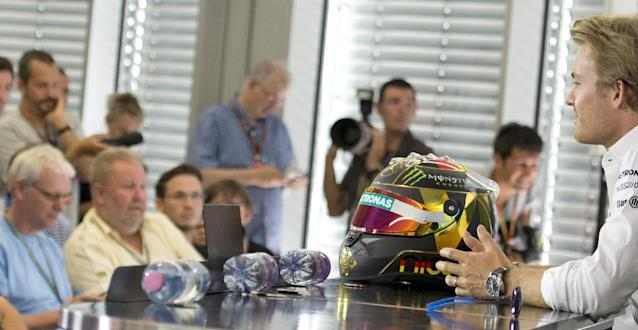 World Championship leader and Mercedes Formula One driver Nico Rosberg of Germany, right, talks with journalists during a press conference in Hockenheim, Germany, Thursday, July 17, 2014. The German Grand Prix will be held on Sunday, July 20, 2014. (AP Photo/Jens Meyer)