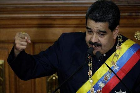 Venezuela's Presidente Nicolas Maduro gestures as he speaks during a session of the National Constituent Assembly at Palacio Federal Legislativo in Caracas