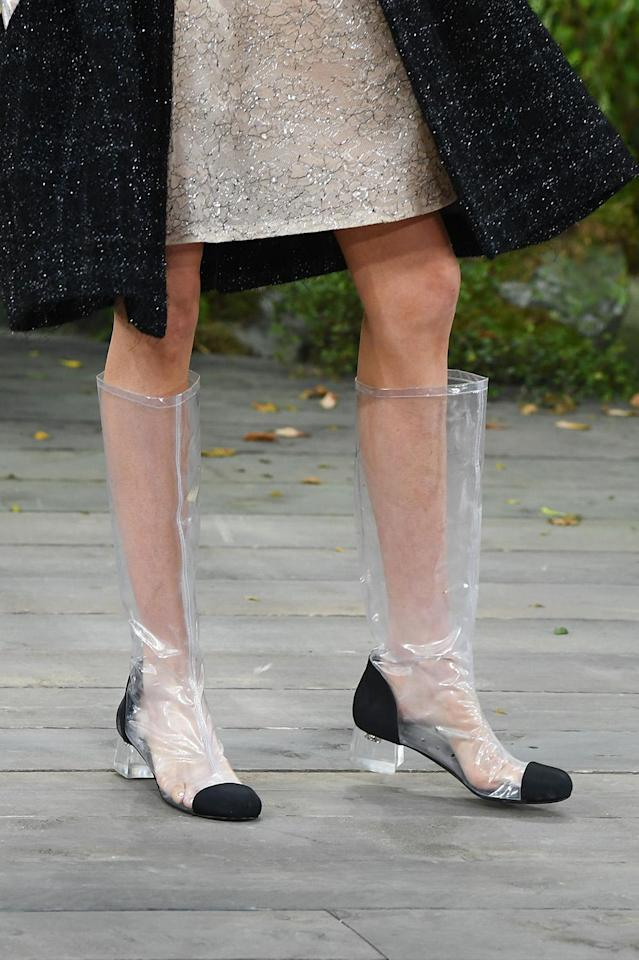 A model walks the runway in high-end PVC boots during the Chanel Spring Summer 2018 show as part of Paris Fashion Week. (Photo: Getty Images)