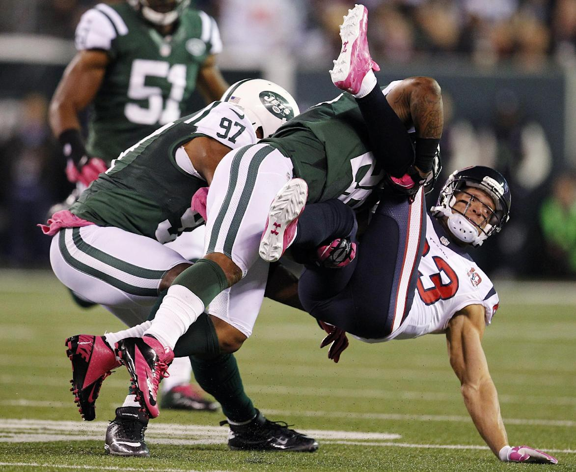 New York Jets defensive back Ellis Lankster (26) tackles Houston Texans wide receiver Kevin Walter (83) during the first half of an NFL football game, Monday, Oct. 8, 2012, in East Rutherford, N.J. (AP Photo/Julio Cortez)