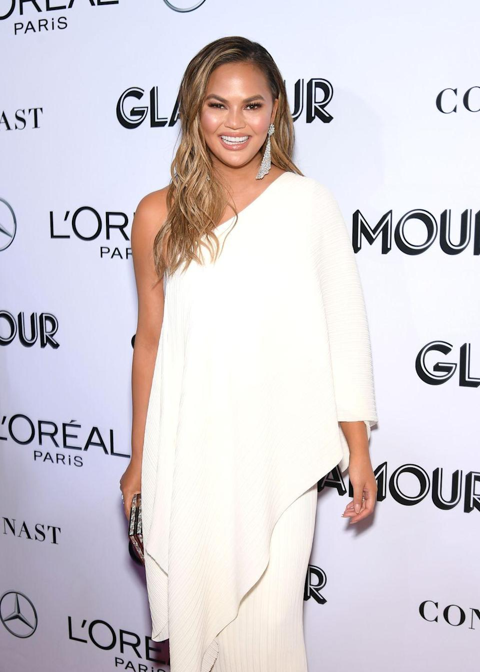 """<p>Though Chrissy <a href=""""https://www.byrdie.com/chrissy-teigen-plastic-surgery"""" rel=""""nofollow noopener"""" target=""""_blank"""" data-ylk=""""slk:previously joked"""" class=""""link rapid-noclick-resp"""">previously joked</a> that """"everything about [her] was fake except [her] cheeks,"""" the <em>Craving</em><em>s </em>author revealed that liposuction is the one surgery she <em>did </em>have. """"I had an armpit sucked out, which was one of the best things,"""" she told <a href=""""https://www.refinery29.com/en-us/2017/05/153132/chrissy-teigen-liposuction-confession"""" rel=""""nofollow noopener"""" target=""""_blank"""" data-ylk=""""slk:Refinery29"""" class=""""link rapid-noclick-resp"""">Refinery29</a>.</p><p>""""It's a big secret, but I don't care... It made me feel better in dresses; I felt more confident. It was the dumbest, stupidest thing I've ever done. The dumbest, but I like it, whatever.""""</p>"""