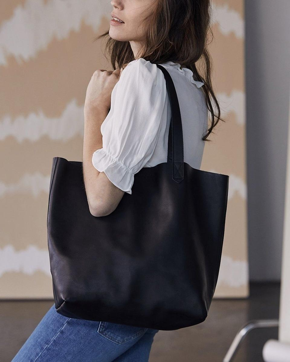 """This is big enough to fit everything you need without weighing down your shoulder.<br /><br /><strong>Promising review:</strong>""""<strong>I splurged on this bag and couldn't be happier with my purchase!</strong>The quality is amazing. It's a sturdy and stylish bag that will hold up for long time!"""" — Autumn B.<br /><br /><strong>Get it from Nisolo for<a href=""""https://go.skimresources.com?id=38395X987171&xs=1&url=https%3A%2F%2Fnisolo.com%2Fproducts%2Fwomens-leather-tote-bag-black&xcust=HPSplurgeWorthy60771eb6e4b01654bb7978a0"""" target=""""_blank"""" rel=""""nofollow noopener noreferrer"""" data-skimlinks-tracking=""""5753950"""" data-vars-affiliate=""""CJ"""" data-vars-asin=""""none"""" data-vars-campaign=""""-SplurgeWorthyBasicsKass10-29-20-5753950/https://nisolo.com/products/womens-leather-tote-bag-black"""" data-vars-href=""""http://www.anrdoezrs.net/links/8209452/type/dlg/sid/-SplurgeWorthyBasicsKass10-29-20-5753950/https://nisolo.com/products/womens-leather-tote-bag-black"""" data-vars-keywords=""""fast fashion"""" data-vars-link-id=""""15974018"""" data-vars-price="""""""" data-vars-product-id=""""1"""" data-vars-product-img=""""none"""" data-vars-product-title=""""Placeholder- no product"""" data-vars-redirecturl=""""https://nisolo.com/products/womens-leather-tote-bag-black"""" data-vars-retailers="""""""" data-ml-dynamic=""""true"""" data-ml-dynamic-type=""""sl"""" data-orig-url=""""http://www.anrdoezrs.net/links/8209452/type/dlg/sid/-SplurgeWorthyBasicsKass10-29-20-5753950/https://nisolo.com/products/womens-leather-tote-bag-black"""" data-ml-id=""""5"""">$170</a>(available in six colors).</strong>"""