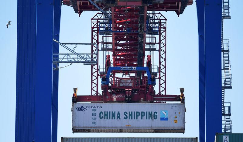 FILE PHOTO: A container of China Shipping is loaded at a loading terminal in the port of Hamburg