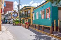"""<p><strong>Let's start big picture. What's the vibe here?</strong> This small town on the southwest coast of Puerto Rico is a great reprieve from the busier cities of <a href=""""https://www.cntraveler.com/gallery/best-day-trips-in-puerto-rico?mbid=synd_yahoo_rss"""" rel=""""nofollow noopener"""" target=""""_blank"""" data-ylk=""""slk:Rincón"""" class=""""link rapid-noclick-resp"""">Rincón</a>, Aguadilla, and Isabela. Here, the water is calm and shallow—so family-friendly—and the kiosks selling oysters and clams, as well as local bars on the main strip, offer relaxed entertainment and sustenance.</p> <p><strong>Any standout features or must-sees?</strong> Balneario de Boquerón, one of the most beautiful beaches in <a href=""""https://www.cntraveler.com/destinations/puerto-rico?mbid=synd_yahoo_rss"""" rel=""""nofollow noopener"""" target=""""_blank"""" data-ylk=""""slk:Puerto Rico"""" class=""""link rapid-noclick-resp"""">Puerto Rico</a>. The water is calm; there are trees for shade; and parking and places to eat are not a far walk.</p> <p><strong>Was it easy to get around?</strong> This is a really flat and easily navigable town.</p> <p><strong>All said and done, what—and who—is this best for?</strong> This is the spot for those who love a calm day at the beach, as well as snacking on fresh seafood.</p>"""