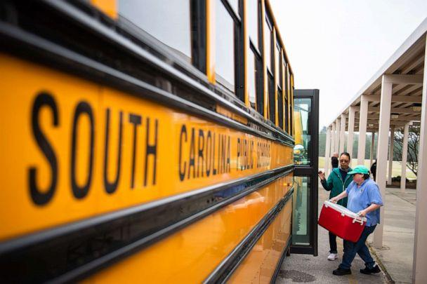 PHOTO: Kershaw County school district staff load buses with food to be delivered to students along their respective routes, March 18, 2020, during the coronavirus pandemic in South Carolina. (Greenville News via USA Today Network, FILE)