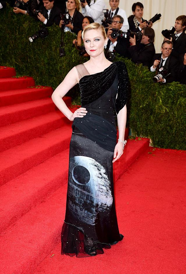 <p>Who says <em>Star Wars</em> fan gear can't be elegant? Not Dunst, who wore a gown featuring the Death Star, from Rodarte's <em>Star Wars</em> Collection, to the 2014 Met Gala. (Photo: Getty Images) </p>