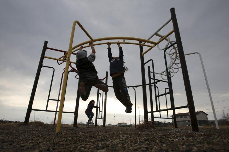 Children play in a playground in the Attawapiskat First Nation in northern Ontario. Reuters Photo.