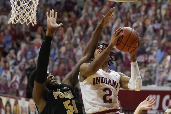 Indiana's Armaan Franklin (2) puts up a shot against Purdue's Trevion Williams (50) during the second half of an NCAA college basketball game, Thursday, Jan. 14, 2021, in Bloomington Ind. Purdue won 81-69. (AP Photo/Darron Cummings)