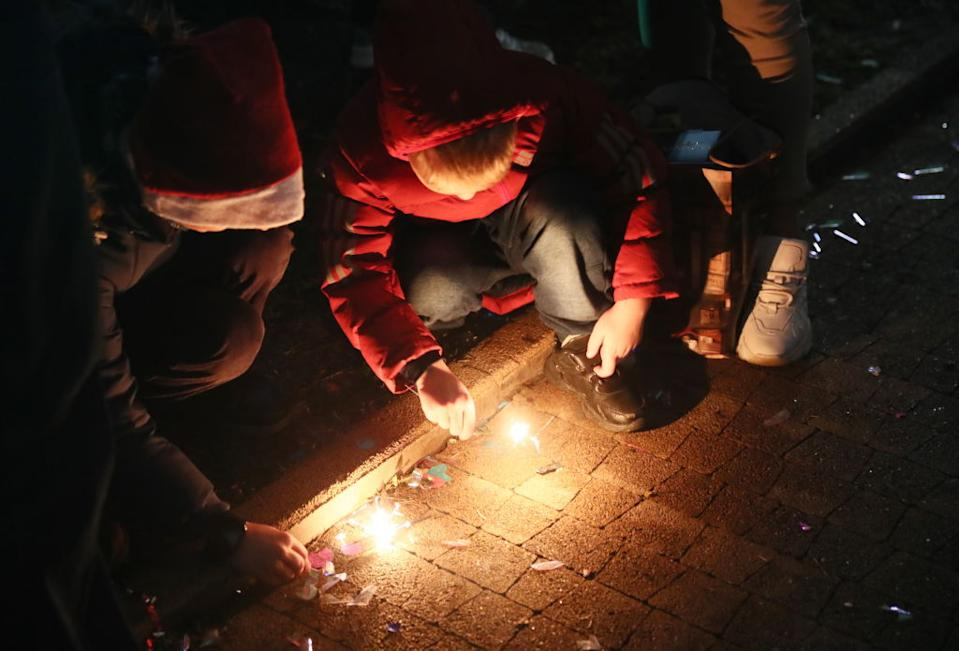 Children light sparklers during New Year celebrations. Source: Getty