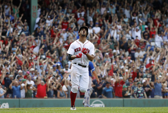 Boston Red Sox' Xander Bogaerts celebrates after his grand slam during the 10th inning of their 6-2 over the Toronto Blue Jays in a baseball game Saturday, July 14, 2018, in Boston. (AP Photo/Winslow Townson)