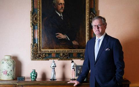 Lord Balfour standing beside a portrait of his ancestor  - Credit:  Christopher Pledger for The Telegraph