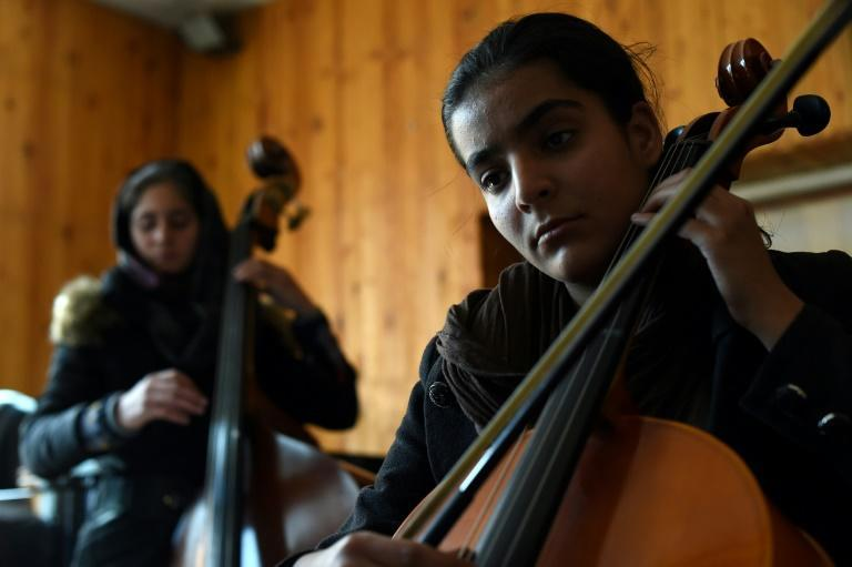 The women of Afghanistan's first all-female orchestra have overcome death threats and discrimination to play together