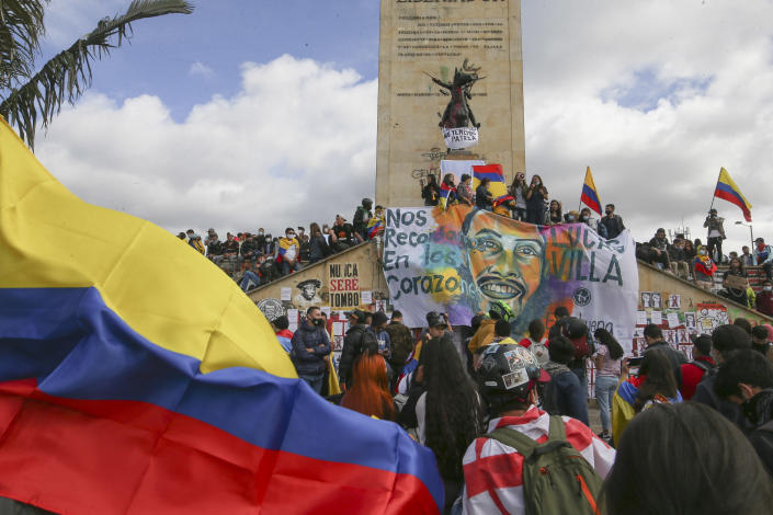 Demonstrators march during an anti-government protest in Bogota, Colombia, Wednesday, May 12, 2021. Colombians have taken to the streets for weeks across the country after the government proposed tax increases on public services, fuel, wages and pensions, but have continued even after President Ivan Duque walked back the tax hike. (AP Photo/Ivan Valencia)
