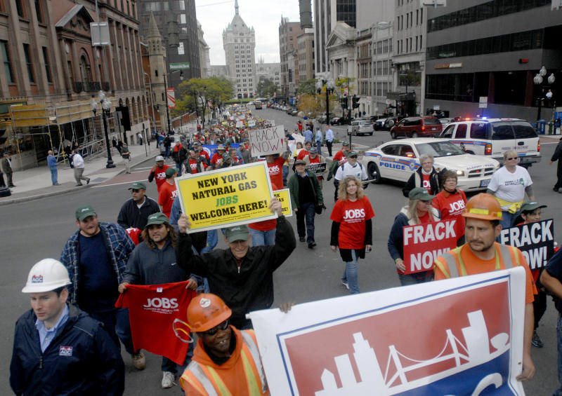 Demonstrators in favor of responsible natural gas drilling in New York march up State Street in Albany, N.Y. on Monday, Oct. 15, 2012. A few hundred people gathered at the Capitol to call for job creation and economic opportunity through natural gas development. (AP Photo/Tim Roske)