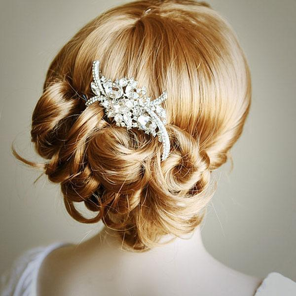 """<div class=""""caption-credit""""> Photo by: Etsy seller GlamorousBijoux</div><div class=""""caption-title"""">1. Jeweled Clip</div>I am head-over-heels about Swarovski crystal-encrusted clips and combs right now. Boasting a royal feel, these vintage-inspired combs and hairpieces are quite the statement piece. Big or small, these work on up-dos and down-dos flawlessly. <br> <br> <a rel=""""nofollow noopener"""" href=""""http://www.etsy.com/listing/69832047/whitney-bridal-hair-comb-art-deco?category=weddings.bridal-accessories.hair"""" target=""""_blank"""" data-ylk=""""slk:Art Deco rhinestone hair comb"""" class=""""link rapid-noclick-resp"""">Art Deco rhinestone hair comb</a> by Etsy seller GlamorousBijoux. <br> <br> <b>Related: <a rel=""""nofollow noopener"""" href=""""http://www.bridalguide.com/photo-galleries/bridal-gowns"""" target=""""_blank"""" data-ylk=""""slk:Find Your Dream Wedding Gown"""" class=""""link rapid-noclick-resp"""">Find Your Dream Wedding Gown</a></b>"""