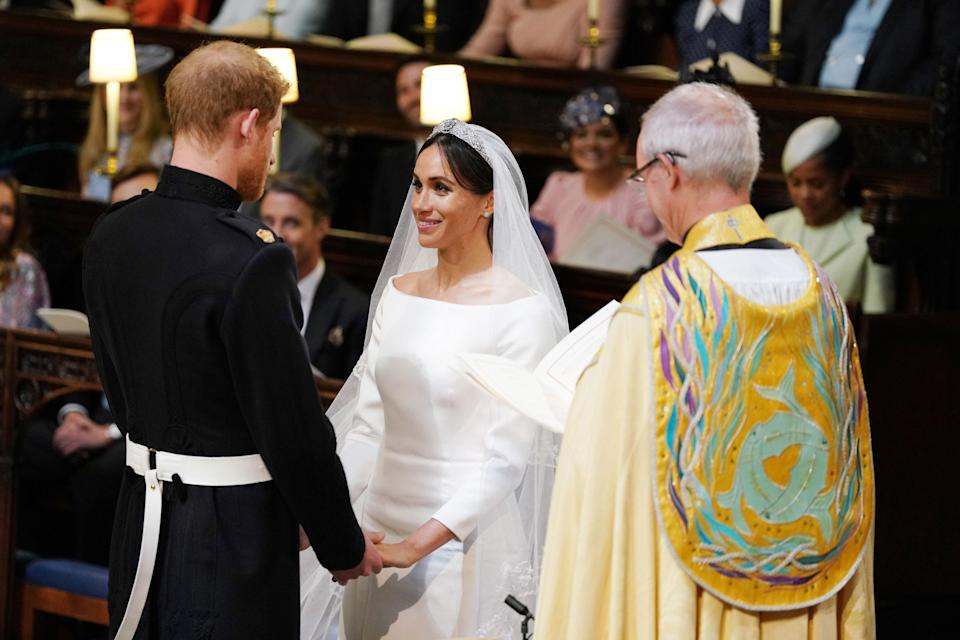 <p>The couple couldn't have looked happier as they make their vows to one another. (PA) </p>
