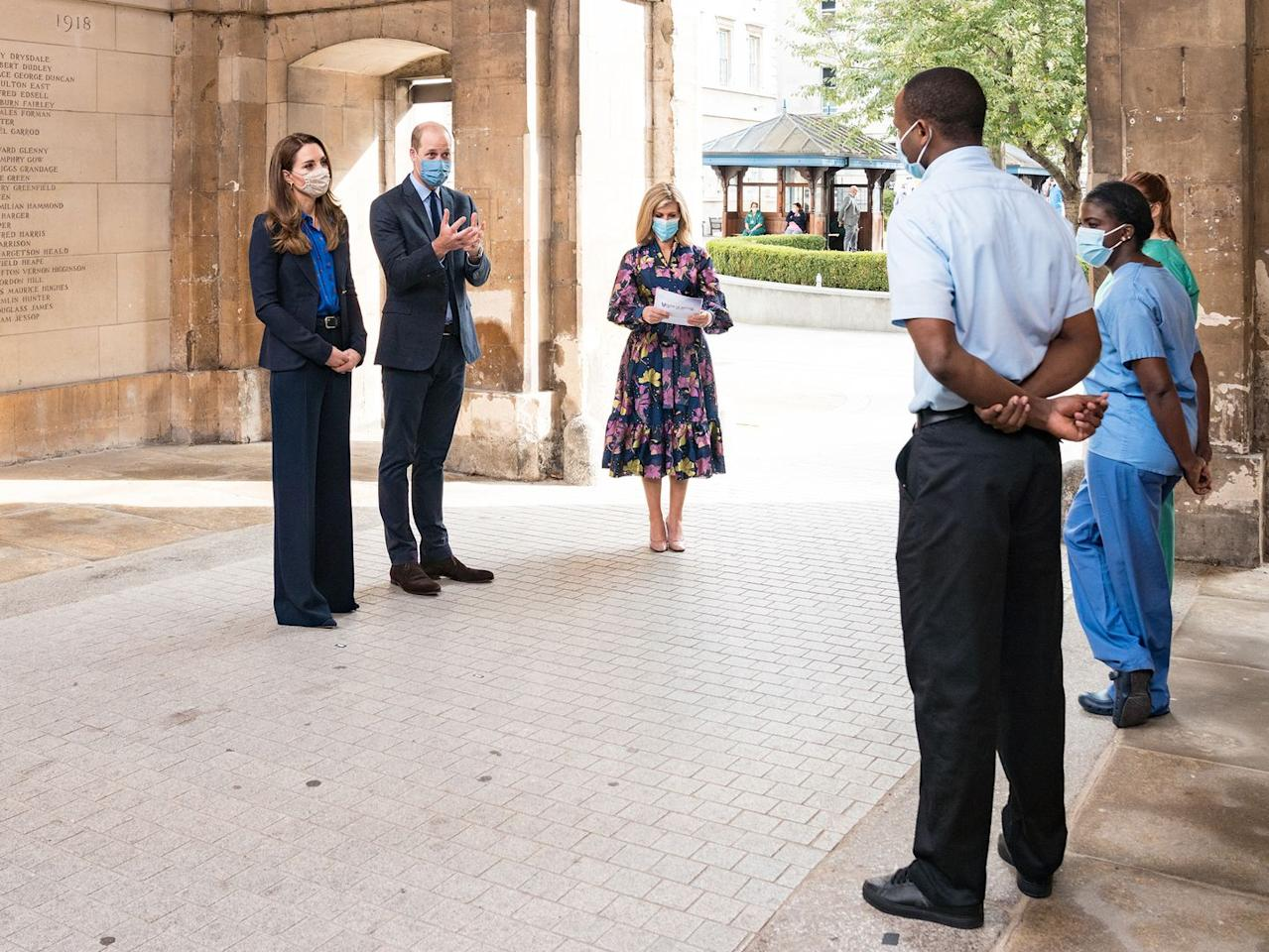 <p>The Duke and Duchess of Cambridge sported matching suits while presenting a Pride of Britain award to NHS frontline workers. The ceremony occurred at London's St Bartholomew's, Britain's oldest free hospital. Of course, the duo paired their pantsuits with protective masks. </p>