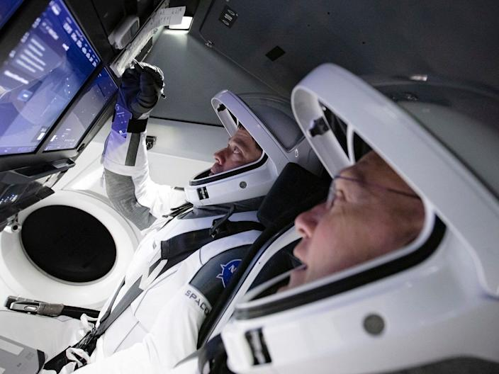 NASA astronauts Bob Behnken and Doug Hurley practicing a full simulation of launch and docking of the Crew Dragon spacecraft on March 19.