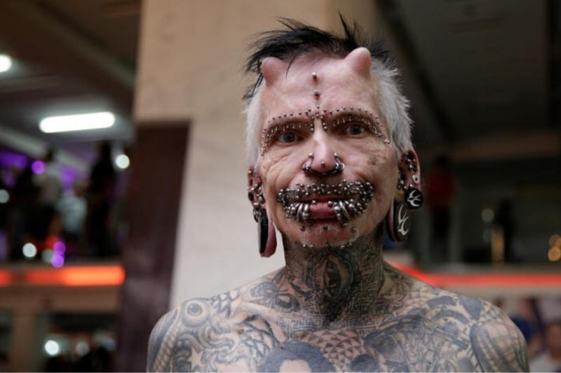 World's Most Pierced Man with a Record of 450 Piercings Shows off His 'Devil Horns'