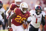 Iowa State running back Breece Hall (28) runs from Texas Tech linebacker Krishon Merriweather (1) during the first half of an NCAA college football game, Saturday, Oct. 10, 2020, in Ames, Iowa. (AP Photo/Charlie Neibergall)