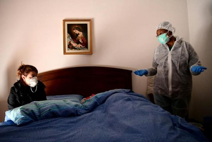 Medically qualified nuns have been carrying out home visots to those infected by the virus (AFP Photo/Piero CRUCIATTI)