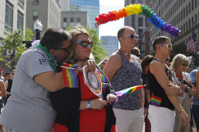 <p>Party attendees join in a moment of silence for the victims of the mass shooting at Orlando's Pulse nightclub during a Pride Month block party in Boston, Massachusetts, U.S. June 12, 2016. (REUTERS/Brian Snyder) </p>