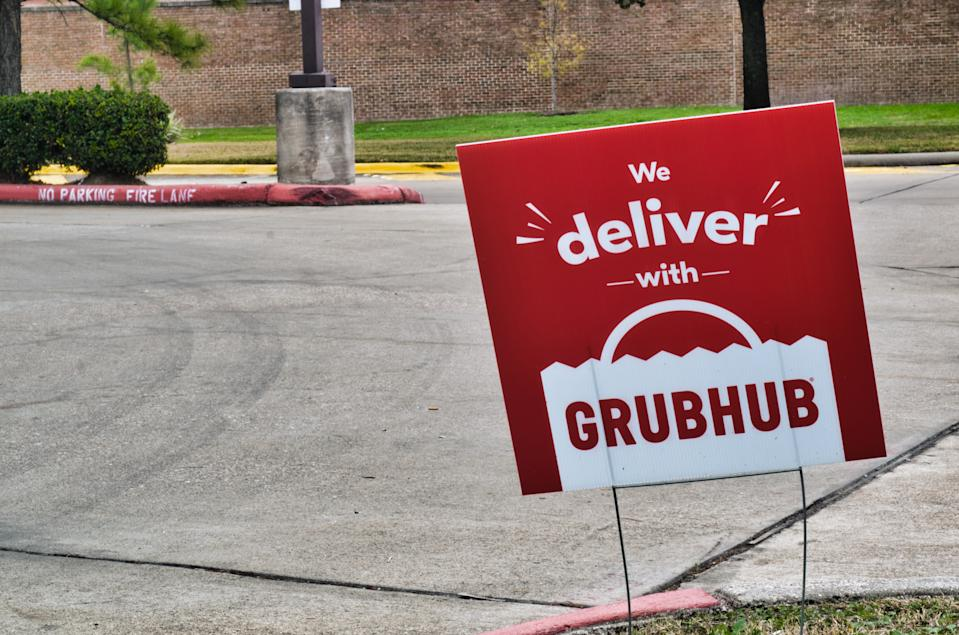 Humble, Texas/USA 01/01/2020: Grubhub sign posted in the ground near some local businesses in Humble, TX. Grubhub is an online fast food delivery service that is becoming increasingly popular in the US.