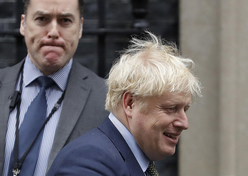 Britain's Prime Boris Johnson leaves 10 Downing Street to attend the weekly Prime Ministers' Questions session in parliament in London, Wednesday, Jan. 15, 2020. (AP Photo/Kirsty Wigglesworth)