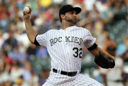Colorado Rockies starting pitcher Tyler Chatwood works against the San Francisco Giants in the first inning of a baseball game in Denver, Saturday, May 18, 2013. (AP Photo/David Zalubowski)