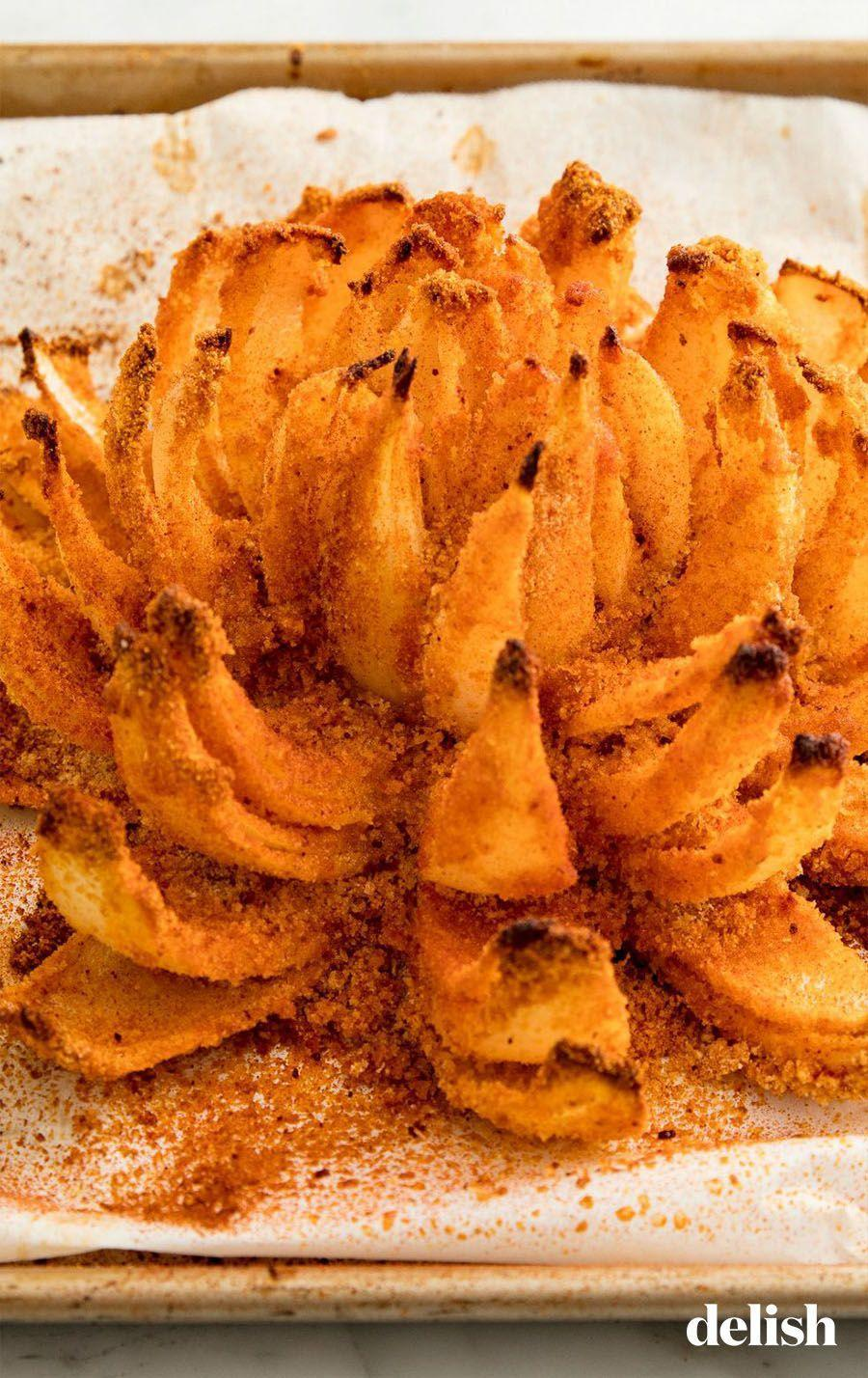 "<p>Who knew you could make this at home, let alone make it healthy?!</p><p>Get the recipe from <a href=""https://patty-delish.hearstapps.com/cooking/recipe-ideas/recipes/a53841/baked-bloomin-onion-recipe/"" rel=""nofollow noopener"" target=""_blank"" data-ylk=""slk:Delish"" class=""link rapid-noclick-resp"">Delish</a>.</p>"