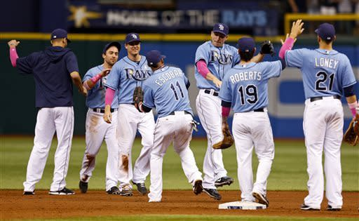 Members of the Tampa Bay Rays celebrate a win over the San Diego Padres in an interleague baseball game Sunday, May 12, 2013, in St. Petersburg, Fla. The Rays won 4-2. (AP Photo/Mike Carlson)