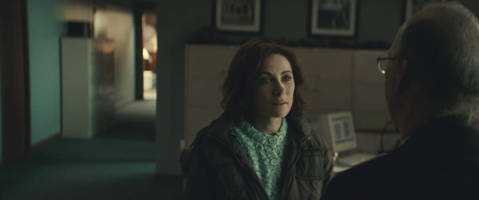"""This image released by Netflix shows Laura Benanti, left, and Michael Keaton in a scene from """"Worth."""" (Netflix via AP)"""