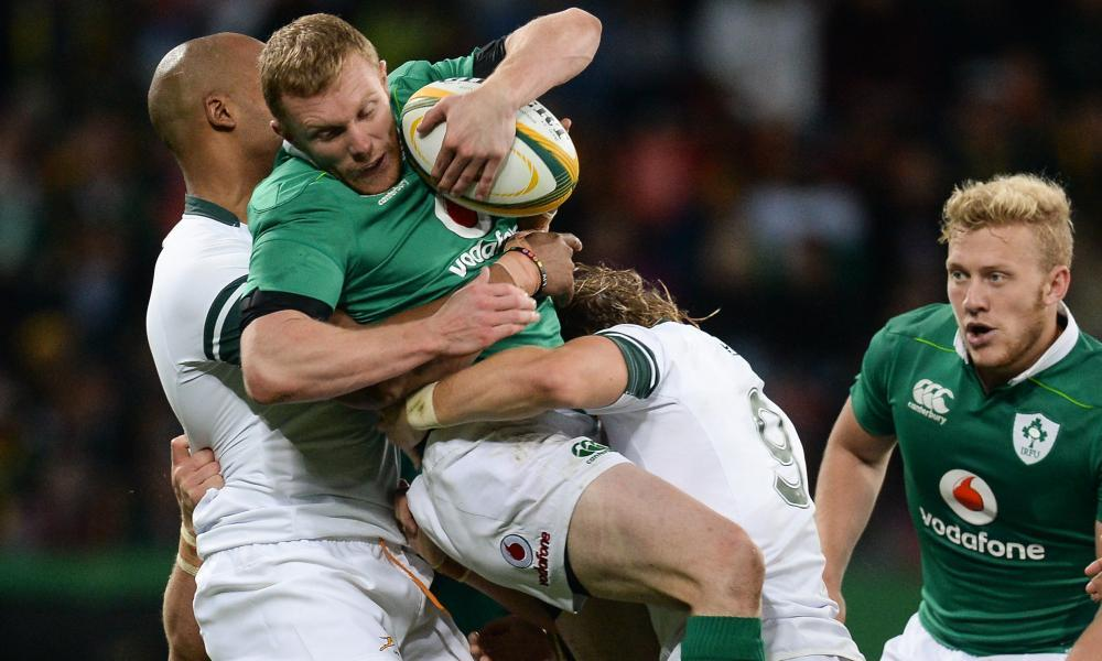 Keith Earls of Ireland is tackled by JP Pietersen and Faf de Klerk during the third Test between the teams in Port Elizabeth last year.