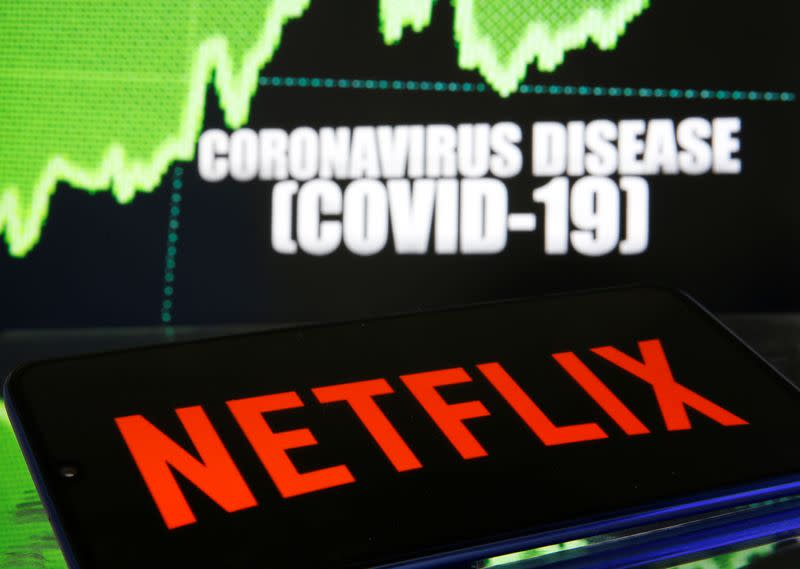 Netlix logo is seen in front of diplayed coronavirus disease (COVID-19)