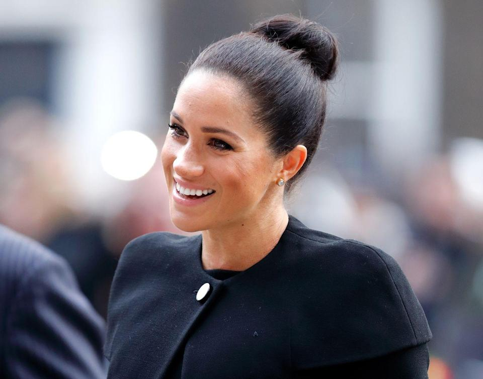 """<p>The Duchess of Sussex kick-started her year by visiting <a href=""""https://www.townandcountrymag.com/society/tradition/a25835910/meghan-markle-royal-patronages-charities/"""" rel=""""nofollow noopener"""" target=""""_blank"""" data-ylk=""""slk:each of her new patronages"""" class=""""link rapid-noclick-resp"""">each of her new patronages</a>. Here she is arriving at an event for the Association of Commonwealth Universities. </p>"""