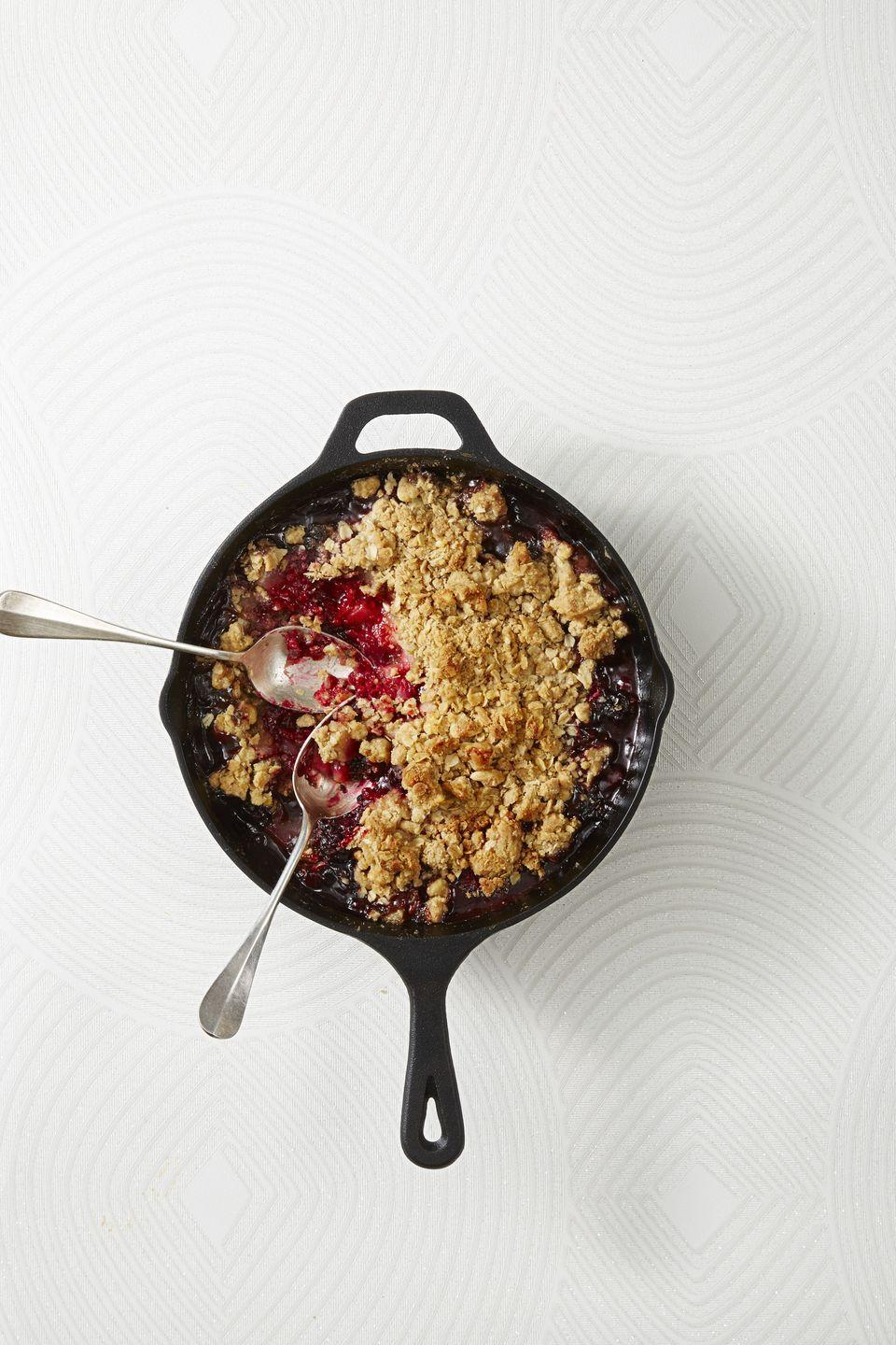 "<p>Here's an excuse to break out your cast iron skillet! We spiced up berries and fresh fall pears, then spiked the filling with amaretto and topped the whole thing with a buttery, crunchy crumble.</p><p><em><a href=""https://www.goodhousekeeping.com/food-recipes/dessert/a42825/spiced-pear-berry-crumble-recipe/"" rel=""nofollow noopener"" target=""_blank"" data-ylk=""slk:Get the recipe for Spiced Pear and Berry Crumble »"" class=""link rapid-noclick-resp"">Get the recipe for Spiced Pear and Berry Crumble »</a></em> </p>"