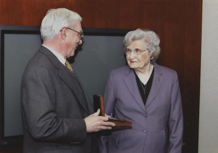 Jack Downing, former CIA deputy director for operations, presents Millie Hewitt in 2005 with her husband's posthumous Distinguished Intelligence Medal, awarded for his work training and running a team of agents that reported on the deployment of Soviet missiles to Cuba in 1962. (Photo: Courtesy Hewitt family)