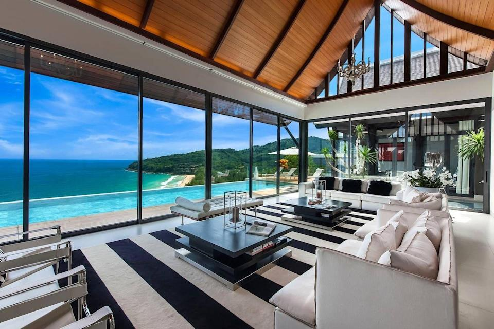 """<p>The floor to ceiling glass walls allow you to see this villa's beautiful pool - and the view from it - wherever you go.</p><p>Book via: <a href=""""https://www.airbnb.co.uk/rooms/9984635?guests=3&adults=3&location=thailand&s=OjpjWJzy"""" rel=""""nofollow noopener"""" target=""""_blank"""" data-ylk=""""slk:Airbnb"""" class=""""link rapid-noclick-resp"""">Airbnb</a></p>"""