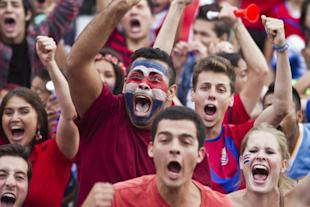Costa Rica soccer fans celebrate their team's victory over Greece. (AP)